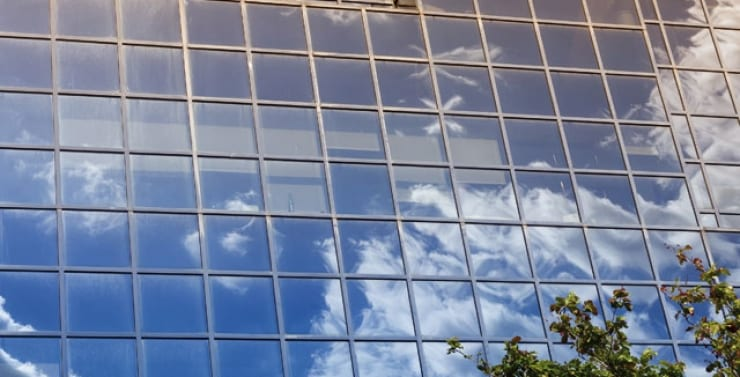 property vision sky reflection in big glass windows